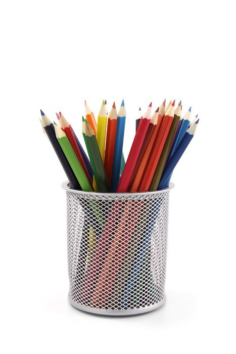 colored pencils in a glass