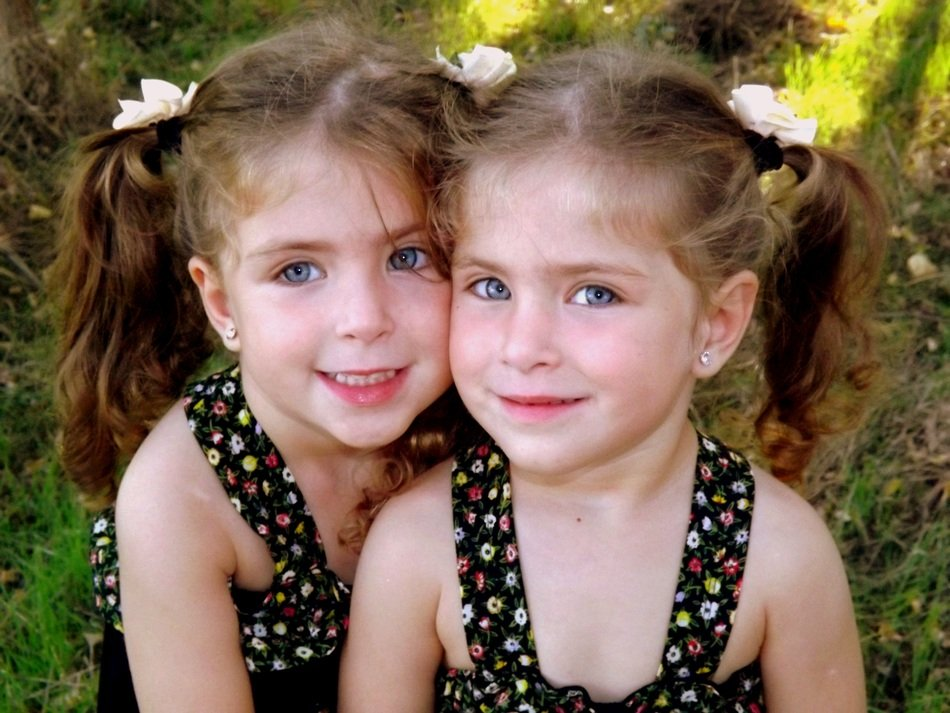 twin sisters with blue eyes