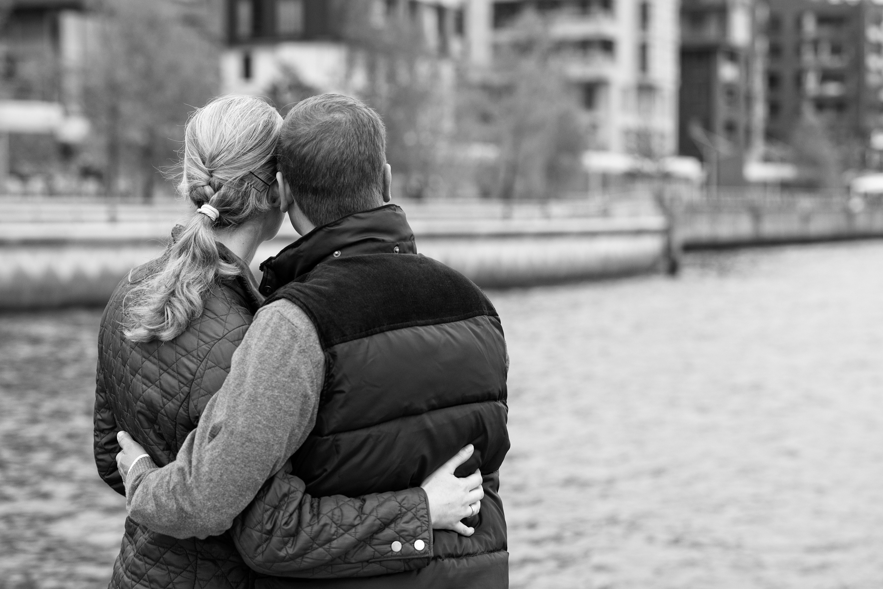Couple in love is hugging on the river bank free image