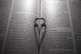 wedding ring on a religious book