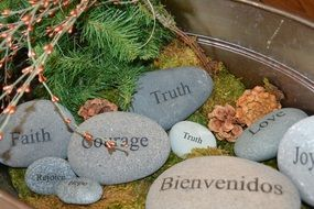 different stones with words