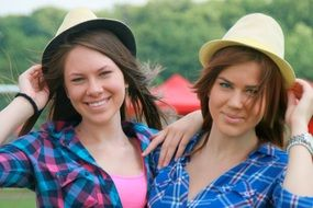 girls in hats smiling