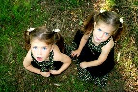 top view of a blue-eyed twin sisters