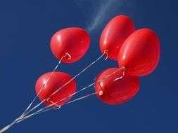 red balloons are a symbol of love