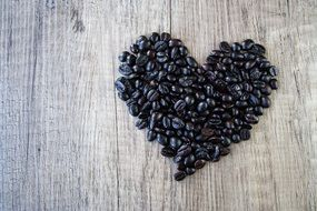 Heart made of the coffee beans on the table