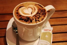 cup of cappuccino with heart on the froth