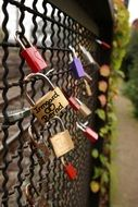 Side view of a fence with locks of love