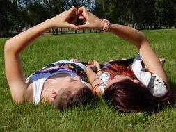 Couple lying on a grass