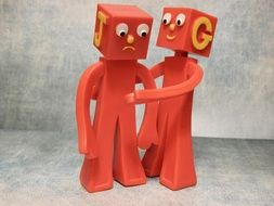 figures resembling embracing friends