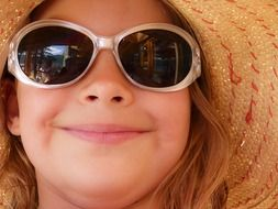 smiling girl in sunglasses