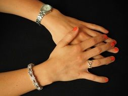 watches and jewelry on female hands
