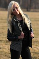 blonde in a leather jacket in the park