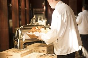 the waiter makes bread on a tray