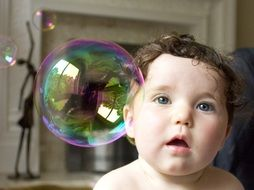 baby and soap bubble