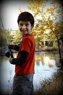 boy fishing happy proud smiling