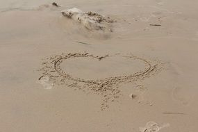 Drawed heart on the sand