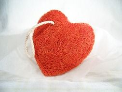red heart-shaped washcloth