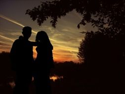 lovers on a background of sunset in the dark