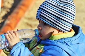 a kid drinking water