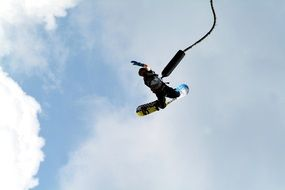man on a bungee snowboard
