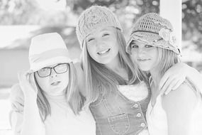 three girls friends in black and white background