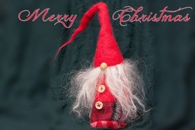 "Gnome made by hands on a background of an inscription ""merry christmas"""