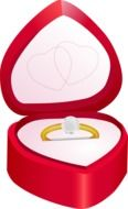 gold ring in a red heart-shaped box