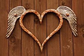 forged heart with wings on the door
