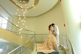 newlyweds on the hotel stairs