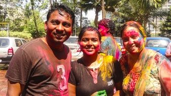 people in colorful paint at indian holi festival