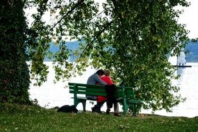 couple in love on benches by the river