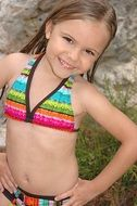 girl in a colorful bathing suit