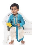happy child in traditional indian costume