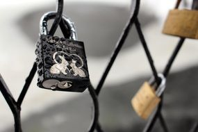 love lock with pair of rabbits on fence, norway, oslo