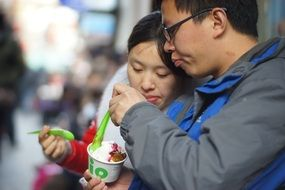 Loving couple eating icecream shanghai