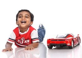 happy boy with red sport car
