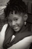 black and white photo of a smiling black girl