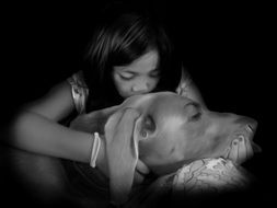 girl is kissing Weimaraner