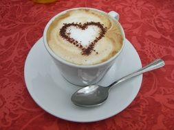 Drawed heart on the cappuccino