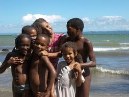 african children laughing on beach