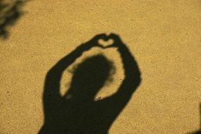 shadow of a girl with a heart over her head