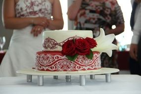 stylish wedding cake with red roses
