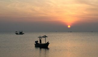 fishing boats on the background of sunrise in Thailand