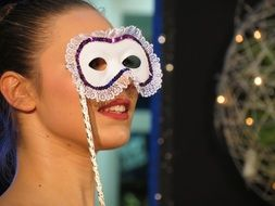 girl with a white carnival mask