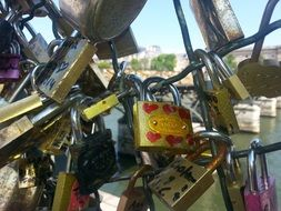metal locks of lovers on a lattice bridge