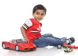 happy boy playing with toy sport car
