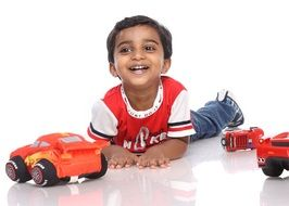 happy boy with toy cars