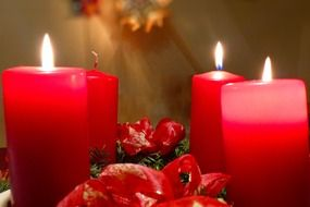 red candles in a christmas wreath