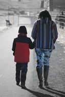 Son is walking with his mother