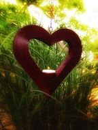 heart and candle in green rays